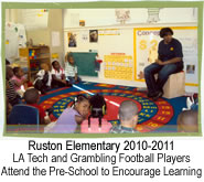 LA Tech and Grambling football players attend the pre-school to encourage learning.