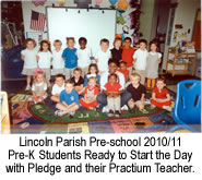 Pre-K students ready to start the day with pledge and their practium teacher.