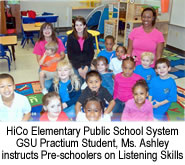 GSU practium student, Ms. Ashley instructs pre-schoolers on listening skills.