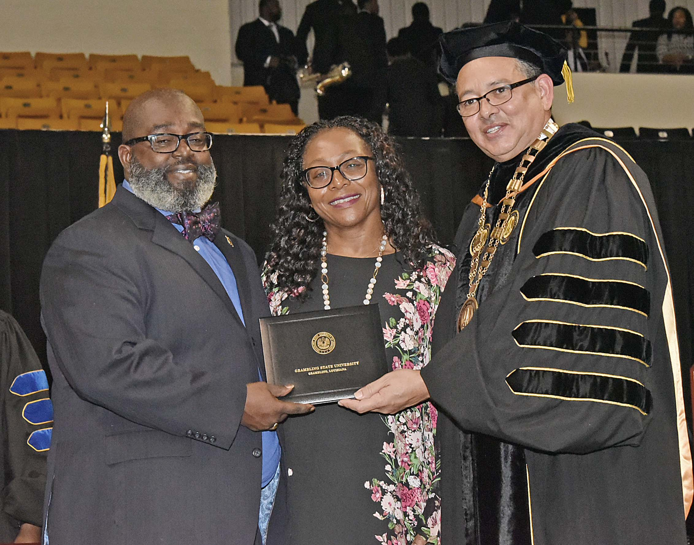 posthumous degree upon Alexis Johnson (parents pictured)