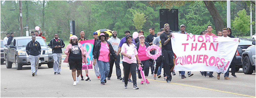 Members of the Grambling State University baseball team and the More Than Conquerors Breast Cancer Support Group march to raise awareness for breast cancer during the baseball team's Pink Strike Out Breast Cancer walk on April 14. Photo by Glen Lewis.
