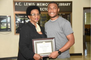 Library certificate presented to Mr. Alickson Alexander by Mrs. Glenda Wade.