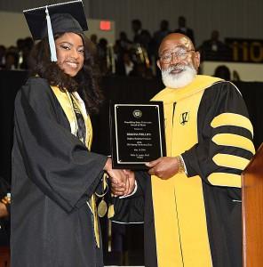 Brianna Phillips, GSU Valedictorian shaking hands with GSU President Willie D. Larkin