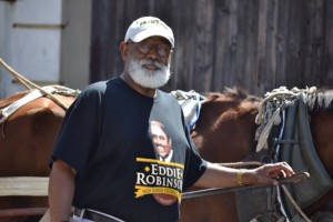 "President Larkin wearing his Eddie G. Robinson t-­shirt & GSU hat in Cienfuegos, Cuba. Larkin expresses, ""Grambling through & through. I love that Black and Gold!"""