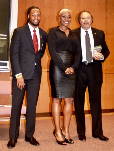 Dorene Bell, new GSU Honor College Inductee, on stage w/Stephen Favors and honors college student president Prentiss Smiley